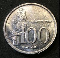Изображение Индонезия 1999 г. • 100 рупий • герб Индонезии • попугай • регулярный выпуск • BU