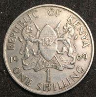 Изображение Кения 1969 г. • KM# 14 • 1 шиллинг • первый год чеканки типа • герб Кении • президент Джомо Кениата • регулярный выпуск • XF+